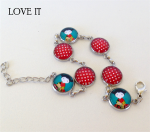 Silver Plated Kokeshi and Spots Cabochon Bracelet from love it